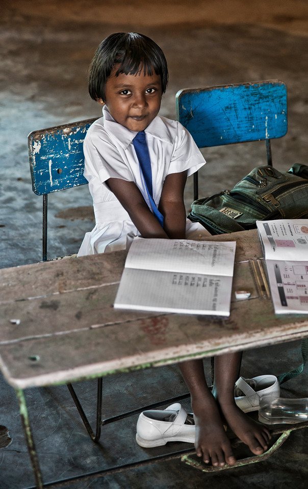 A little school girl enjoys being photographed in class.<br /> <br /> Sri Lanka, 2014.