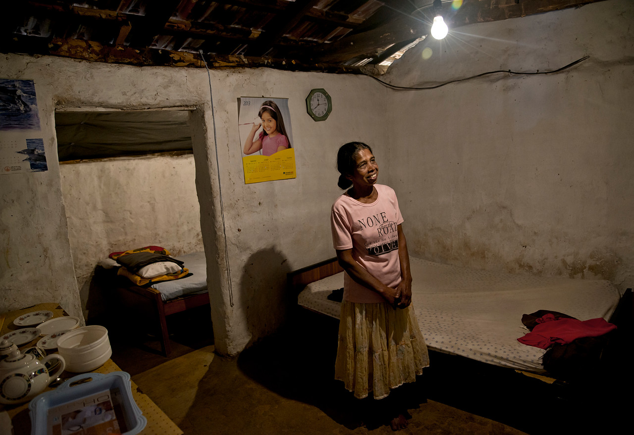Vigelata aged 49 lives in her twenty year old mud house built by her late father-in-law. Vigelata has four sons, three of whom are in school. The eldest is unemployed and passes the time with Vigelata. They both scan the area for tourists. They offer a cup of tea and a wonderful view from her home of the surrounding area, in exchange for a small donation. Vigelata's husband works in Colombo as a truck driver and rarely has the time or money to come and visit.<br /> <br /> Ella, Sri Lanka, 2014