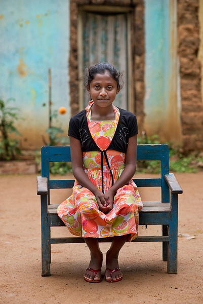 Young girl sitting outside her home.<br /> <br /> Ella, Sri Lanka, 2014
