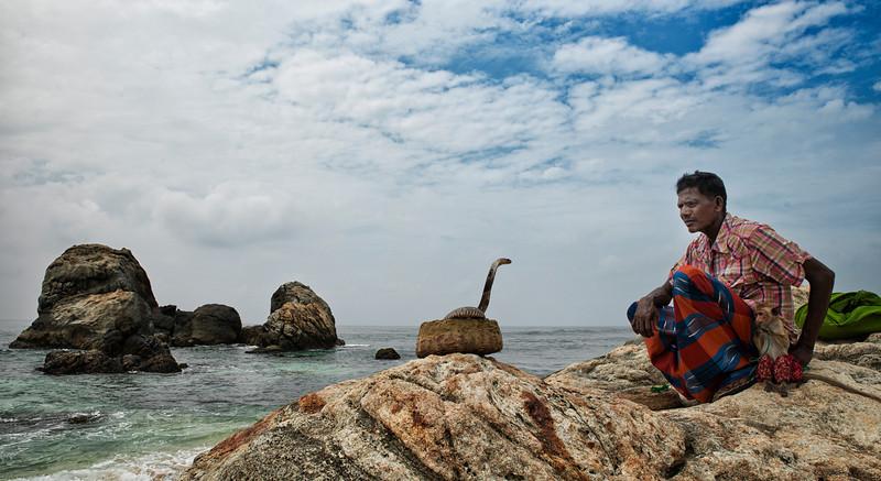 Snake charmer on the Weligama coast.<br /> <br /> Sri lanka, 2014.