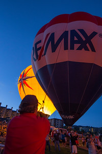 Hot air balloons glow together at the base of Mt. Werner as a part of the weekend's events in Steamboat Springs, CO.