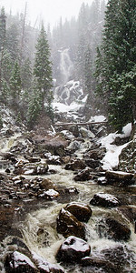 Fish Creek Falls in a spring snowstorm.