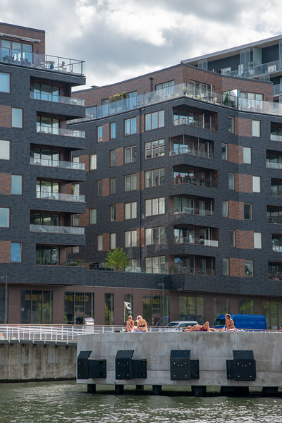 Residents of Stockholm come out take in the Sun. Royal Canal Tour of Stockholm on a ferry which is included in the Stockholm Pass.