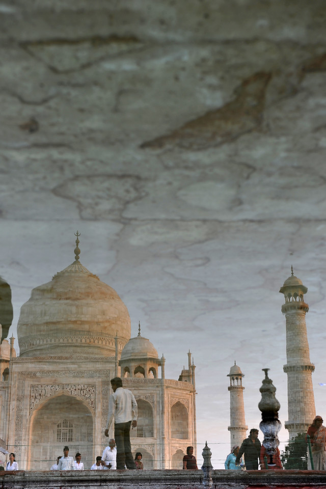 """Reflections of Taj Mahal.<br /> The garden uses raised pathways that divide each of the four quarters of the garden into 16 sunken parterres or flowerbeds. A raised marble water tank at the center of the garden, halfway between the tomb and gateway with a reflecting pool on a north-south axis, reflects the image of the mausoleum. The raised marble water tank is called al Hawd al-Kawthar, in reference to the """"Tank of Abundance"""" promised to Muhammad. Due to its shape, the dome is often called an onion dome or amrud (guava dome). The marble dome that surmounts the tomb is the most spectacular feature."""