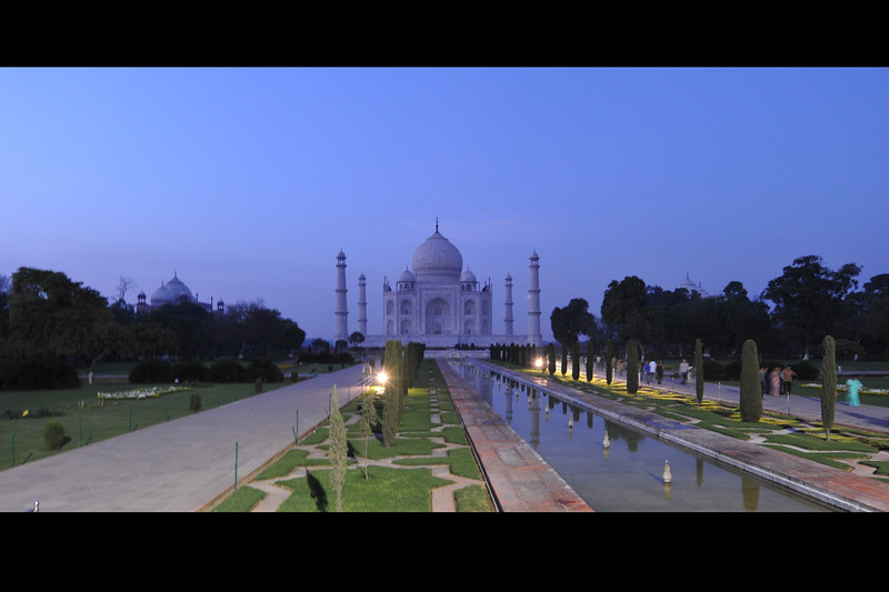The Taj Mahal looks grand on a moon lit night. The white marble shivers with the light. The decorative elements were created by applying paint, stucco, stone inlays, or carvings.  As tripods are not allowed, the blue hour shots were taken hand held at the Taj Mahal, Agra, India right at sunset when the complex closes down to visitors.