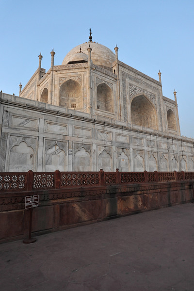Taj Mahal. Each minaret is effectively divided into three equal parts by two working balconies that ring the tower. At the top of the tower is a final balcony surmounted by a chattri that mirrors the design of those on the tomb. The chattris all share the same decorative elements of a lotus design topped by a gilded finial. The minarets, which are each more than 40 metres (130 ft) tall, display the designer's penchant for symmetry.