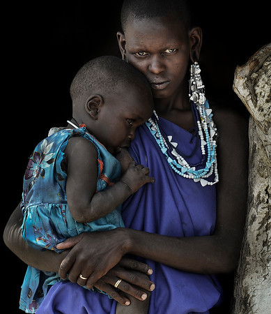 A young Masai mother with her baby.   Tanzania, 2019