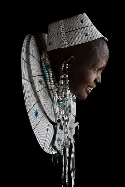 """The Maasai are traditionally polygynous; this is thought to be a long-standing and practical adaptation to high infant and warrior mortality rates. Polyandry is also practiced. However, today this practice is usually abandoned. A woman marries not just her husband but the entire age group. Men are expected to give up their bed to a visiting age-mate guest; however, today this practice is usually abandoned. The woman decides strictly on her own if she will join the visiting male. Any child which may result is the husband's child and his descendant in the patrilineal order of Maasai society. """"Kitala"""", a kind of divorce or refuge, is possible in the house of a wife's father, usually for gross mistreatment of the wife. Repayment of the bride price, custody of children, etc., are mutually agreed upon.  Tanzania, 2019"""