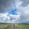 Woman and Dog Under Cloud Formation