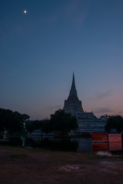 Past sunset at the Wat Phu Khao Thong in Ayutthaya, Thailand. A buddhist temple founded in 1569, with a 50-m. chedi (stupa) restored in the 18th century.