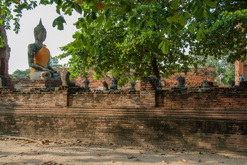 The Wat Mahathat is a Buddhist temple in Ayutthaya, Central Thailand were one seens ruins as well as colorful shrines & the famed Buddha head surrounded by tree roots.