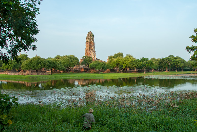 View of Wat Phra Ram,  in Ayutthaya, Thailand from across the road and water body.