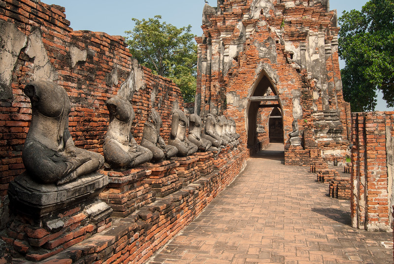 Headless torsos of Buddha: Many Buddha statue heads were chopped and taken away by invading army of Myanmar (Burma) both as a sign of force and since some heads were adorned by gold. Chai Watthanaram Temple, Ayutthaya, Thailand is a Buddhist temple in the city of Ayutthaya's Historical Park on the west bank of the Chao Phraya River. It is one of Ayutthaya's best known temples and a major tourist attraction. There are restored and not restored ruins of a 17th-century royal Buddhist temple in a picturesque, riverside setting.
