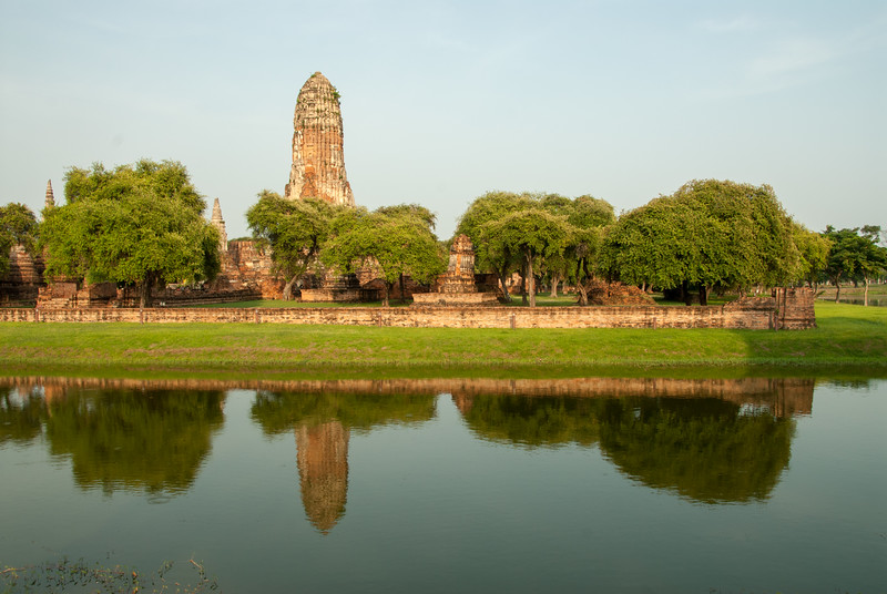 View of Wat Phra Ram,  inAyutthaya, Thailand from across the water body.