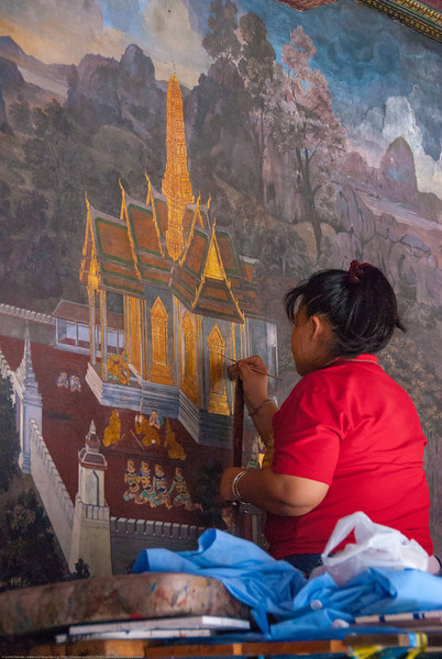 Restoration work at the Wat in Bangkok, Thailand. Large landmark temples offering serene grounds with the giant & famous reclining Buddha, historic art & statues.