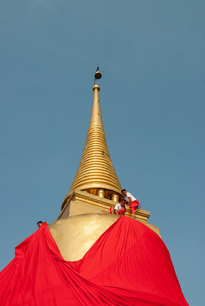 Golden top of The Golden Mount, Bangkok, Thailand. Wat Saket Ratcha Wora Maha Wihan usually called: Wat Saket. The temple dates back to the Ayutthaya era, when it was known as Wat Sakae. When Bangkok became the capital, King Rama I renovated the temple and gave it its present name.