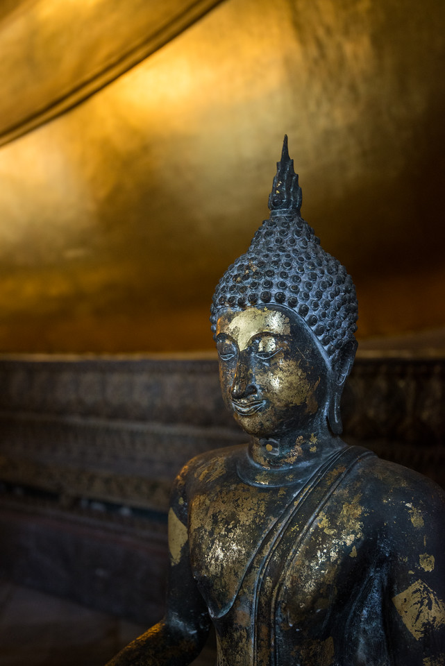 Wat Pho (Thai: วัดโพธิ์). Temple of the Reclining Buddha, its official name is Wat Phra Chetuphon Vimolmangklararm Rajwaramahavihar.<br /> <br /> Wat Pho, is a contraction of its older name Wat Photaram. The temple is first on the list of six temples in Thailand classed as the highest grade of the first-class royal temples. It is associated with King Rama I who rebuilt the temple complex on an earlier temple site, and became his main temple where some of his ashes are enshrined. The temple was later expanded and extensively renovated by Rama III. The temple complex houses the largest collection of Buddha images in Thailand, including a 46 m long reclining Buddha. The temple is considered the earliest centre for public education in Thailand, and the marble illustrations and inscriptions placed in the temple for public instructions has been recognised by UNESCO.