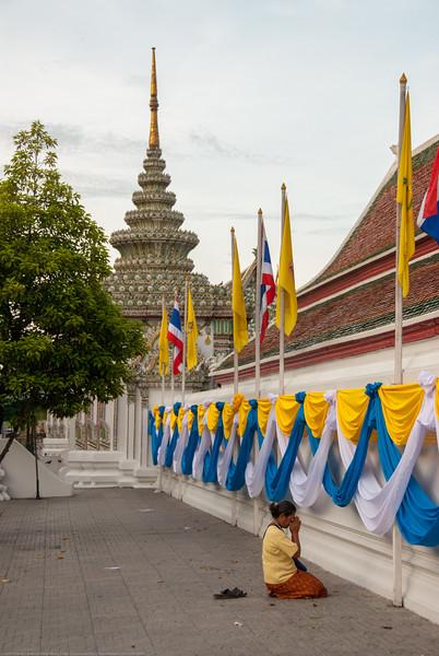 Prayers offered at the Grand Palace, Bangkok, Thailand.