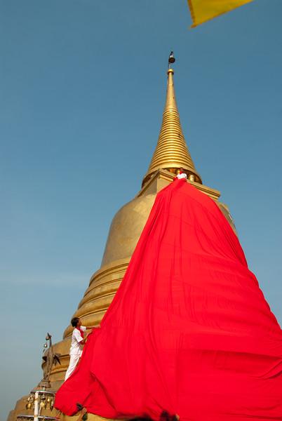 Golden top of The Golden Mount, Bangkok, Thailand. Wat Saket Ratcha Wora Maha Wihan usually called: Wat Saket. The temple dates back to the Ayutthaya era, when it was known as Wat Sakae. When Bangkok became the capital, King Rama I renovated the temple and gave it its present name.
