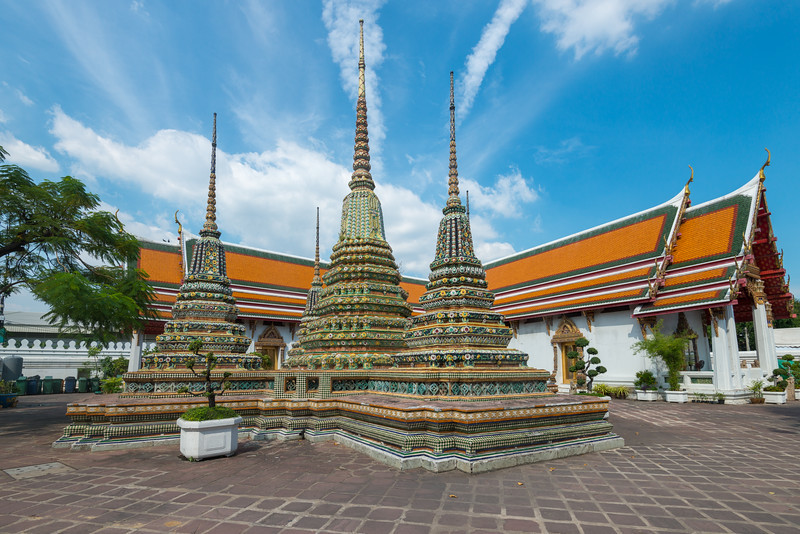 Wat Pho (Thai: วัดโพธิ์). Temple of the Reclining Buddha Complex. Wat Phra Chetuphon Vimolmangklararm Rajwaramahaviharn.<br /> <br /> The temple complex houses the largest collection of Buddha images in Thailand, including a 46 m long reclining Buddha. The temple is considered the earliest centre for public education in Thailand, and the marble illustrations and inscriptions placed in the temple for public instructions has been recognised by UNESCO.