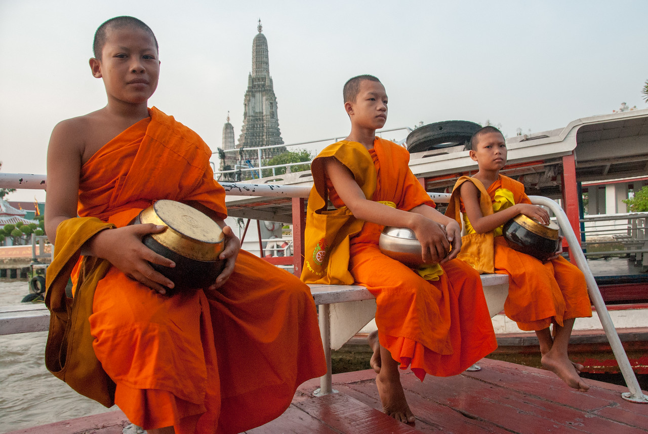 Young buddhist monks at Wat Arun Ratchawararam Ratchawaramahawihan, Bangkok, Thailand.<br /> <br /> Wat Arun Ratchawararam Ratchawaramahawihan or Wat Arun is a Buddhist temple in Bangkok Yai district of Bangkok, Thailand, on the Thonburi west bank of the Chao Phraya River.