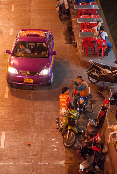 Bike taxi and regular taxi - various transport options at Patpong, Bangkok, Thailand.<br /> <br /> One of the world's most famous red-light districts, Patpong is where Thailand's Go-Go culture all started. It has even been immortalised in a James Bond chase-sequence. Its two parallel side-streets, found between Silom and Surawongse Roads, house dozens of neon-lit strip bars offering naughty shows