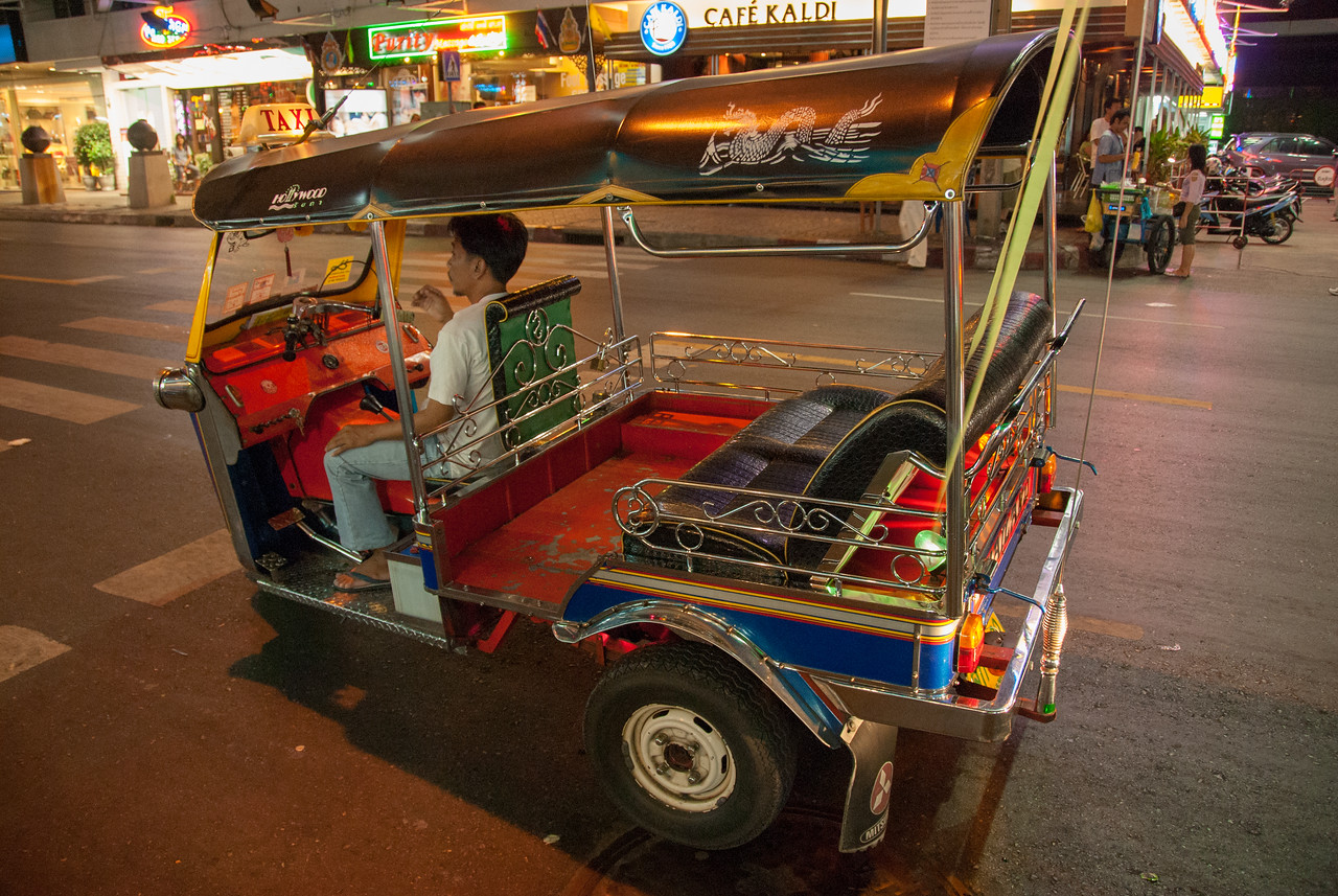 Tuk-tuk in Patpong, Bangkok, Thailand.<br /> <br /> One of the world's most famous red-light districts, Patpong is where Thailand's Go-Go culture all started. It has even been immortalised in a James Bond chase-sequence. Its two parallel side-streets, found between Silom and Surawongse Roads, house dozens of neon-lit strip bars offering naughty shows