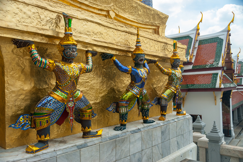 Grand Palace in Bangkok Thailand with dancing demons holding up roof.
