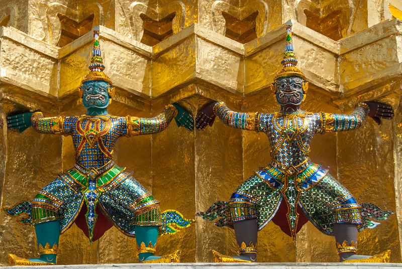 Wat in Bangkok, Thailand. Large landmark temples offering serene grounds with the giant & famous reclining Buddha, historic art & statues.