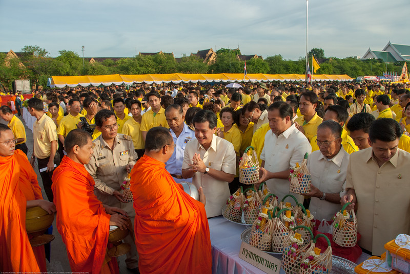 Monks receiving alms from royalty at the celebrations in Bangkok, Thailand.