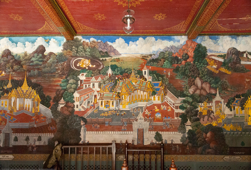 Beautiful murals and wall paintings. Wat in Bangkok, Thailand. Large landmark temples offering serene grounds with the giant & famous reclining Buddha, historic art & statues.