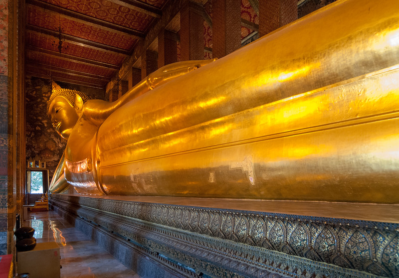 Wat Pho (Reclining Buddha) ( วัดโพธิ์), Bangkok, Thailand.<br /> <br /> The temple complex houses the largest collection of Buddha images in Thailand, including a 46 m long reclining Buddha.<br /> <br /> The temple is highest on the list of six temples in Thailand classed as the highest grade of the first-class royal temples. It is associated with King Rama I who rebuilt the temple complex on an earlier temple site, and became his main temple where some of his ashes are enshrined. The temple was later expanded and extensively renovated by Rama III.