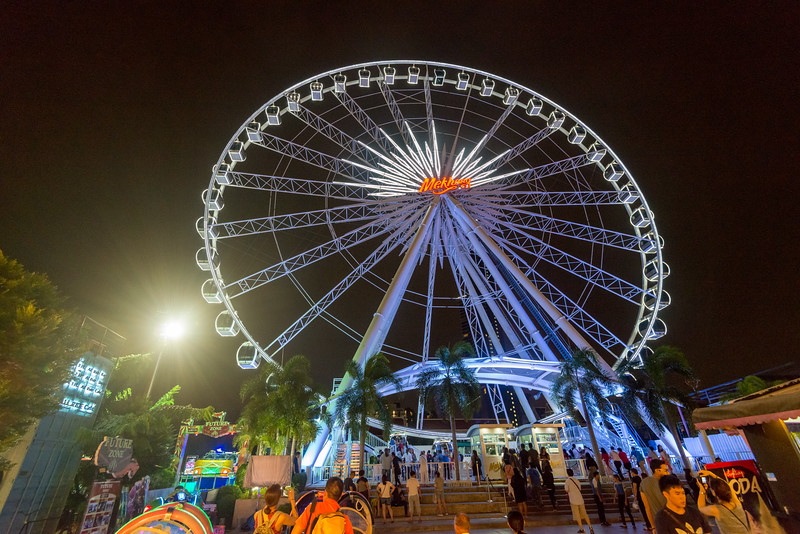 Gaint Ferris Wheel at Asiatique The Riverfront, Bangkok, Thailand which is a large open-air mall and occupies the former docks of the East Asiatic Company. Illuminated at night, it has a sizable Ferris wheel which offers a scenic river views. It opened in April, 2012 and faces the Chao Phraya River and Charoen Krung Road.