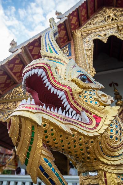 Entrance to Wat Phra Singh Woramahawihan (วัดพระสิงห์วรมหาวิหาร ), 14th-century Buddhist temple boasting gold & copper Buddhas, murals & ancient manuscripts. Chiang Mai, Thailand.