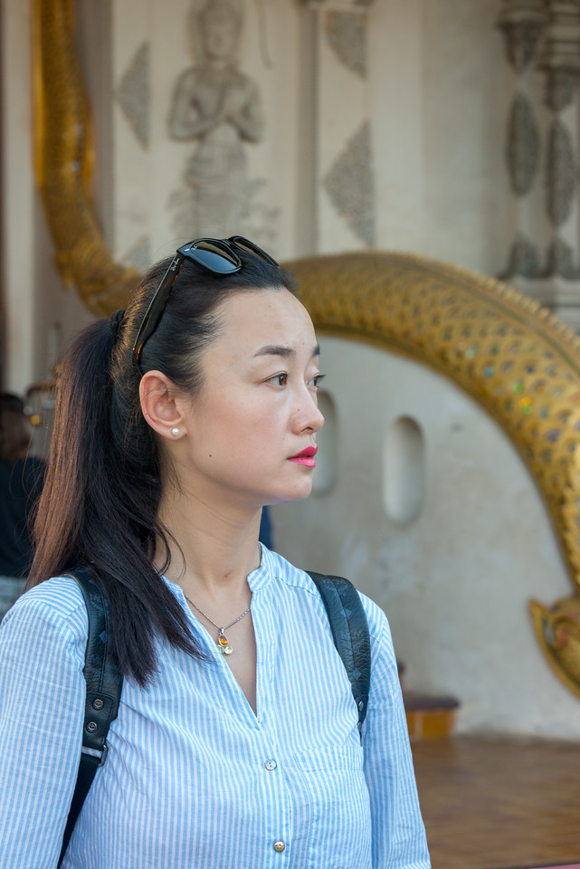 Visitor to Wat Chedi Luang (วัดเจดีย์หลวง) (temple of the big stupa or temple of the royal stupa). <br /> Wat Chedi Luang is a Buddhist temple in the historic centre of Chiang Mai, Thailand. The current temple grounds were originally made up of three temples — Wat Chedi Luang, Wat Ho Tham and Wat Sukmin. Chiang Mai, Thailand.