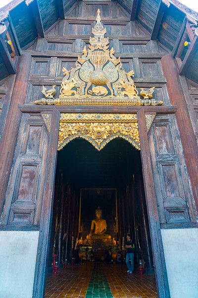 Entrance to Monks at Wat Phan Tao (วัดพันเตา). Intricate teak Buddhist temple with gilded accents & colorful mosaics, founded in the 14th century.Chiang Mai, Thailand.