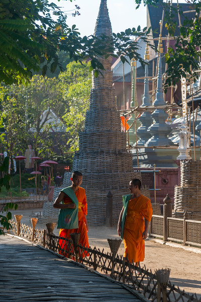 Buddhist monks walking in Monks at Wat Phan Tao (วัดพันเตา) and Phonrat Witthayakon (Wat Phan Tao) School. Buddhist temple founded in the 14th century. Chiang Mai, Thailand.