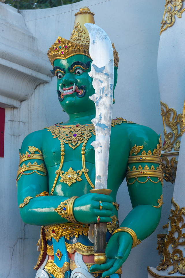 Statue of guards at the entrance to Chiang Mai Pillar City Shrine (ศาลหลักเมืองเชียงใหม่) and Wat Chedi Luang, Chiang Mai, Thailand.