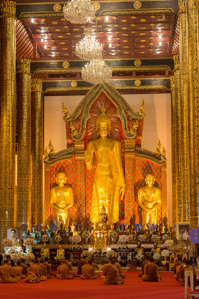 Monks chanting inside the viharn. Wat Chedi Luang (วัดเจดีย์หลวง) (temple of the big stupa or temple of the royal stupa)<br /> Wat Chedi Luang is a Buddhist temple in the historic centre of Chiang Mai, Thailand. The current temple grounds were originally made up of three temples — Wat Chedi Luang, Wat Ho Tham and Wat Sukmin. Chiang Mai, Thailand.