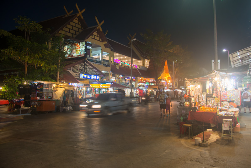 Night view of Chiang Mai Night Bazaar which is situated East of the city moat, on Chang Khlan Road. It is known for its handicrafts and portrait paintings. Chiang Mai, Thailand.