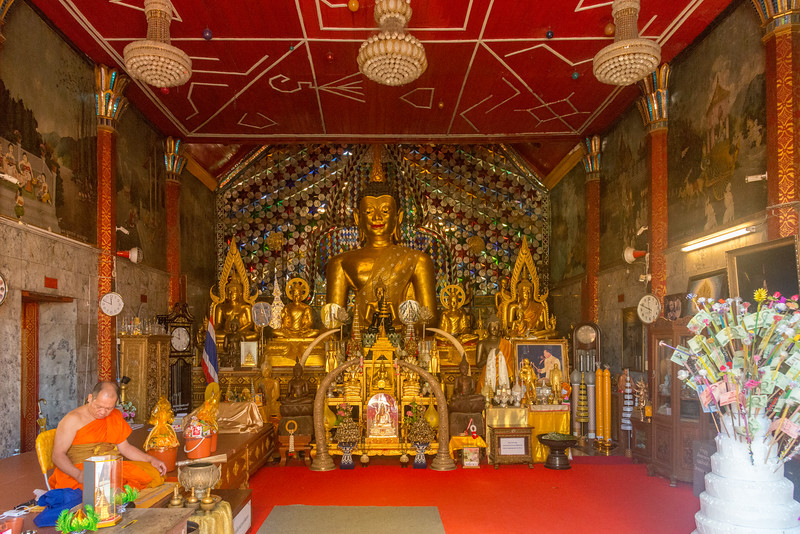 """Buddha statues at Wat Phrathat Doi Suthep (วัดพระธาตุดอยสุเทพ), a Theravada wat in Chiang Mai Province, Thailand. The temple is often referred to as """"Doi Suthep"""" although that is the name of the mountain where it's located. This is a sacred site to many Thai people and is also referred as the ornate temple complex. The complex features a golden stupa, statues & a legendary white elephant shrine."""