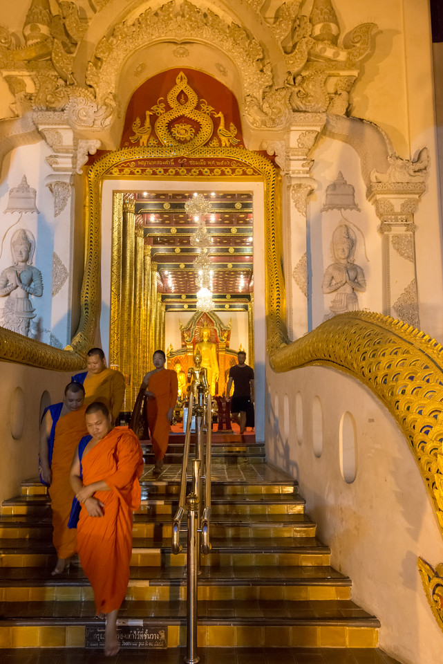Monks returning after prayers under the evening lights at  Wat Chedi Luang (วัดเจดีย์หลวง) (temple of the big stupa or temple of the royal stupa). <br /> Wat Chedi Luang is a Buddhist temple in the historic centre of Chiang Mai, Thailand. The current temple grounds were originally made up of three temples — Wat Chedi Luang, Wat Ho Tham and Wat Sukmin. Chiang Mai, Thailand.