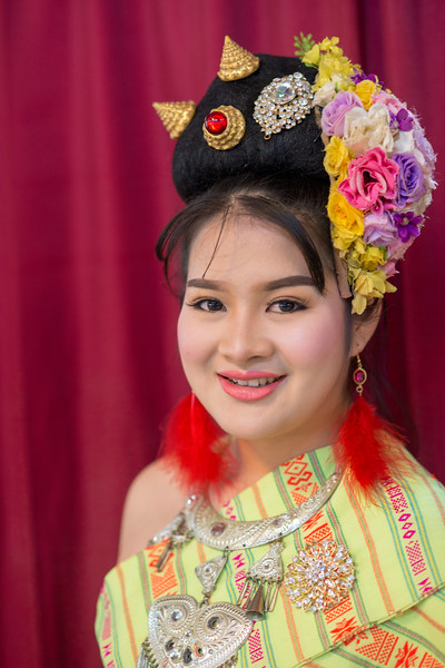 Portrait of the traditionally dressed young girl who is a dancer at the Kalare Night Bazaar, Chiang Mai, Thailand.