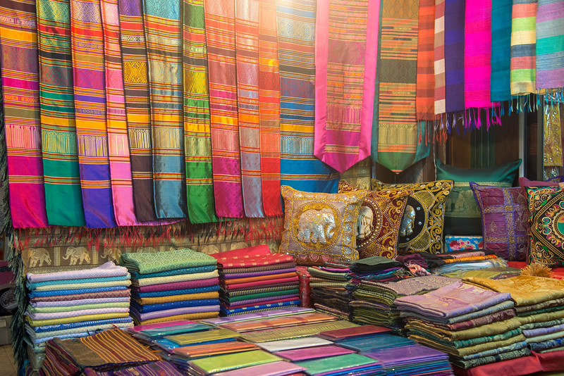 Beautiful Thai silk. Chiang Mai Night Bazaar is situated East of the city moat, on Chang Khlan Road. It is known for its handicrafts and portrait paintings. Chiang Mai, Thailand.