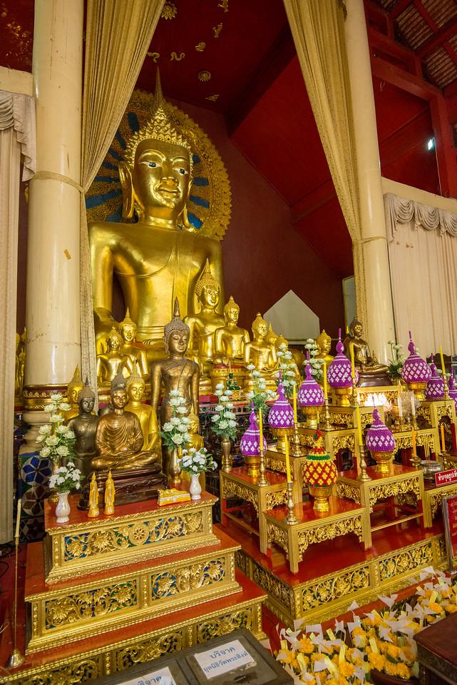 Golden Buddha statue inside Wat Phra Singh Woramahawihan (วัดพระสิงห์วรมหาวิหาร ), 14th-century Buddhist temple boasting gold & copper Buddhas, murals & ancient manuscripts.Chiang Mai, Thailand.