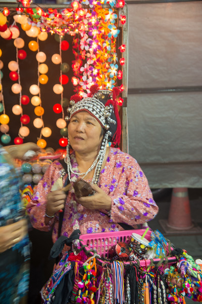 Street vendors come from other regions to sell to tourists. Chiang Mai Night Bazaar is situated East of the city moat, on Chang Khlan Road. It is known for its handicrafts and portrait paintings. Chiang Mai, Thailand.