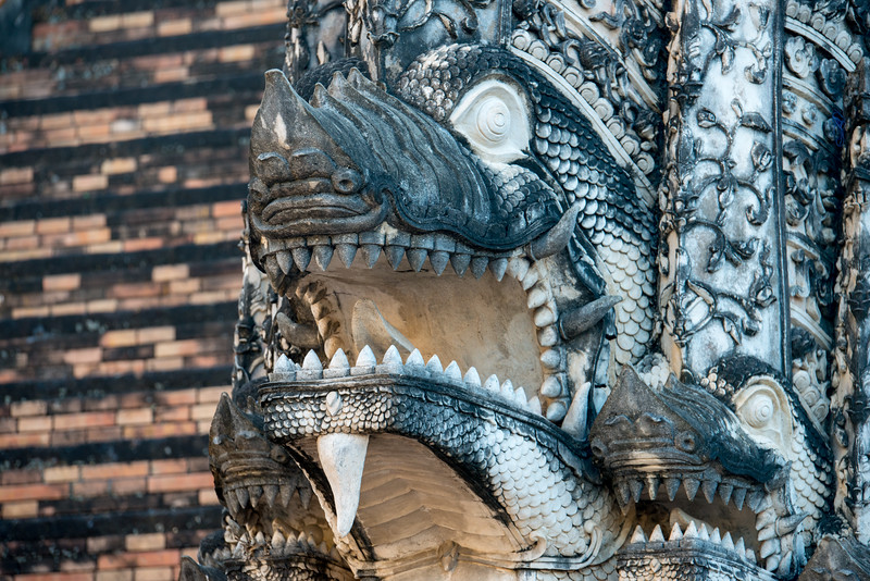 Close up of the architecture of the Wat Chedi Luang (วัดเจดีย์หลวง) (temple of the big stupa or temple of the royal stupa). <br /> Wat Chedi Luang is a Buddhist temple in the historic centre of Chiang Mai, Thailand. The current temple grounds were originally made up of three temples — Wat Chedi Luang, Wat Ho Tham and Wat Sukmin. Chiang Mai, Thailand.