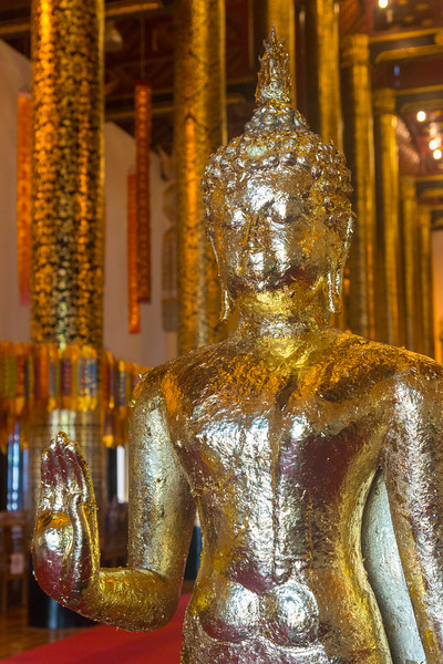 Golden Buddha statue at Wat Chedi Luang (วัดเจดีย์หลวง) <br /> Wat Chedi Luang is a Buddhist temple in the historic centre of Chiang Mai, Thailand. The current temple grounds were originally made up of three temples — Wat Chedi Luang, Wat Ho Tham and Wat Sukmin. Chiang Mai, Thailand.