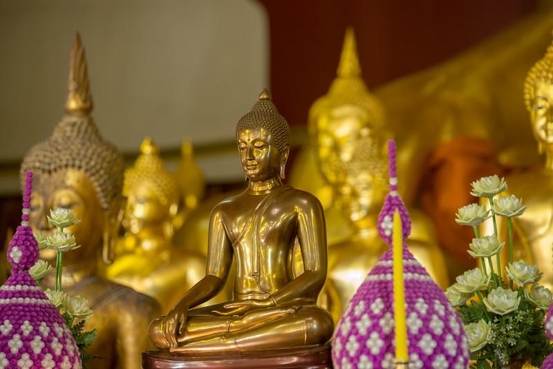 Many golden Buddha statues inside Wat Phra Singh Woramahawihan (วัดพระสิงห์วรมหาวิหาร ), 14th-century Buddhist temple boasting gold & copper Buddhas, murals & ancient manuscripts.Chiang Mai, Thailand.
