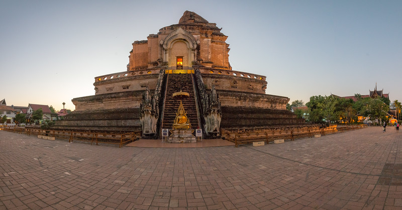 Evening at Tourists at Wat Chedi Luang (วัดเจดีย์หลวง) (temple of the big stupa or temple of the royal stupa). <br /> Wat Chedi Luang is a Buddhist temple in the historic centre of Chiang Mai, Thailand. The current temple grounds were originally made up of three temples — Wat Chedi Luang, Wat Ho Tham and Wat Sukmin. Chiang Mai, Thailand.